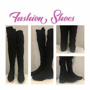 Thigh high flat boot